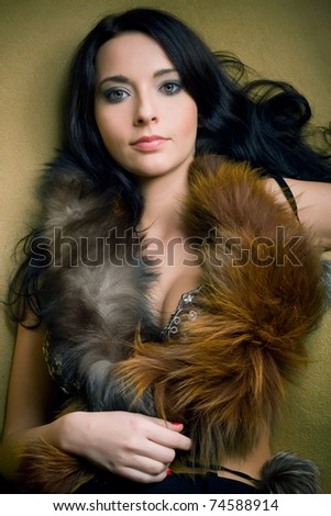 attractive brunette glamor girl with brown boa