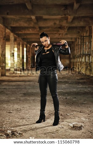 attractive brunette in black posing - stock photo