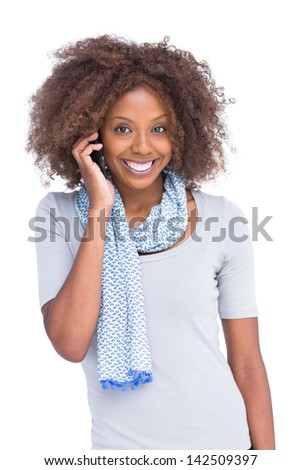 Attractive brunette on the phone on white background