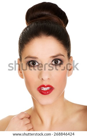 Attractive brunette topless woman with dark make up. - stock photo
