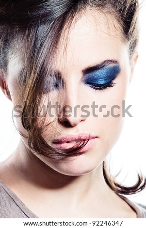 attractive brunette with strong eyes make up, studio shot