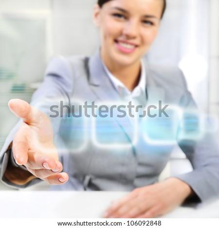 Attractive brunette with virtual interface in futuristic interior - stock photo