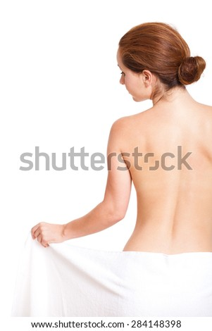 attractive brunette woman covered only by a towel - stock photo
