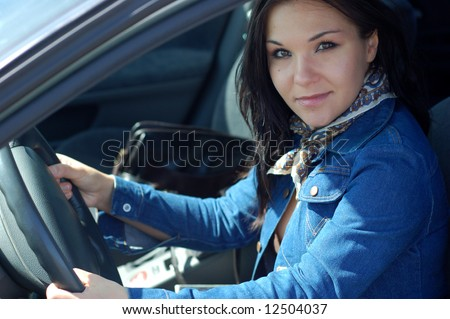 attractive brunette woman happy in new car