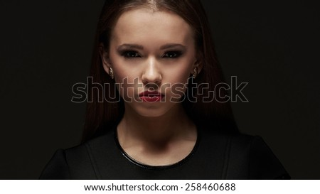 Attractive brunette woman on black background - stock photo