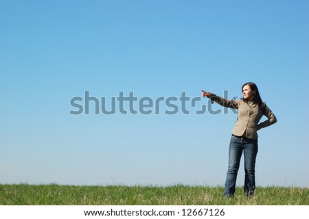 attractive brunette woman on sky background