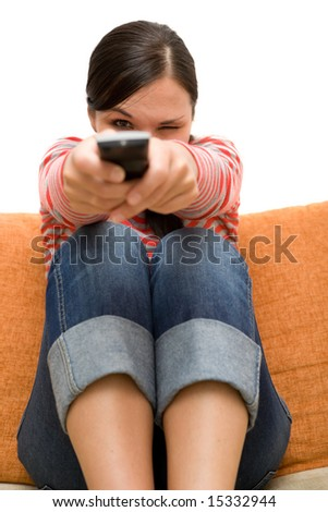 attractive brunette woman on sofa - stock photo
