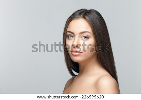 attractive brunette woman portrait on white background - stock photo