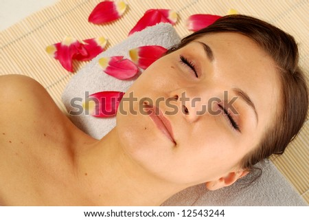 attractive brunette woman relaxing in spa salon