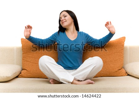 attractive brunette woman relaxing on sofa - stock photo
