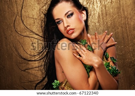 Attractive brunette woman with blowing hairs - stock photo