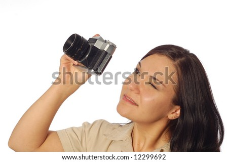 attractive brunette woman with old camera