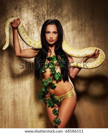Attractive brunette woman with python - stock photo