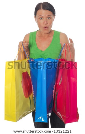 attractive brunette woman with shopping bags on white background