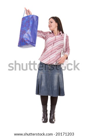 attractive brunette woman with shopping bags. over white background