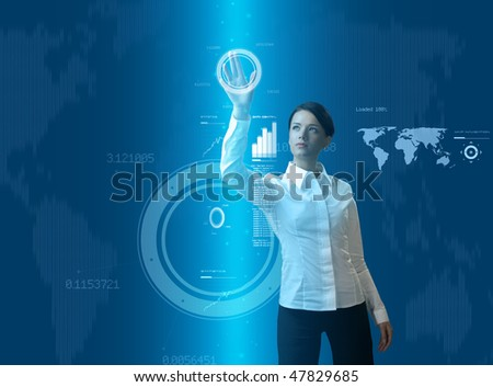 Attractive brunette young woman in futuristic interface (business people in virtual space photo collages series) - stock photo