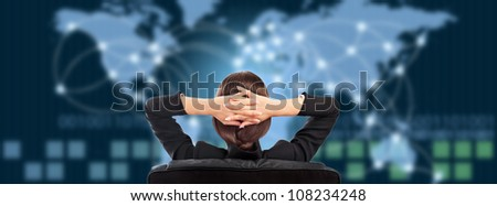 Attractive brunette young woman in futuristic interface sitting in front of world map with glowing hot points location and connection lines. - stock photo