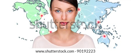 Attractive brunette young woman in futuristic interface standing in front of world map with glowing hot points location and connection lines. - stock photo