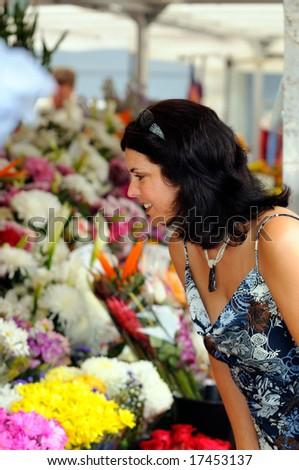 Attractive Brunette Young Woman Shopping At A Flower Market - stock photo