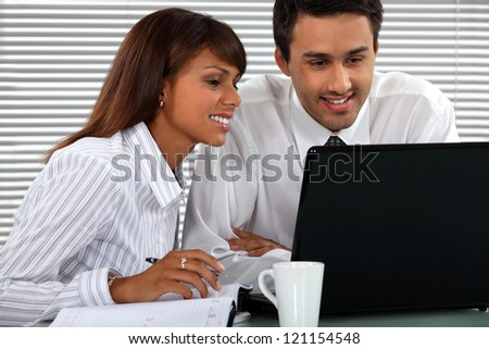 Attractive business couple - stock photo