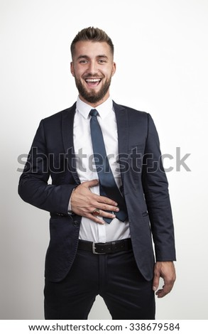 Attractive business man is laughing out loud - stock photo