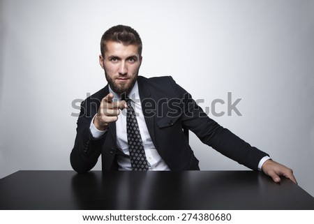 Attractive business man is pointing with his finger - stock photo