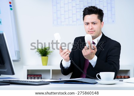 attractive business man overloaded at work in office