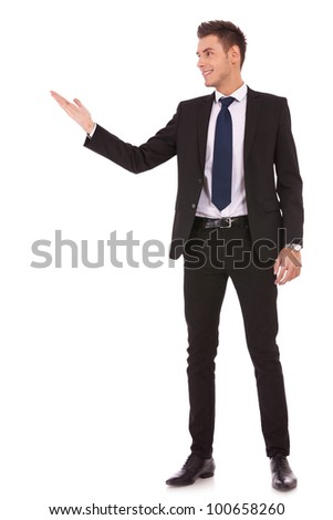 Attractive business man shows you copy space on white background - stock photo