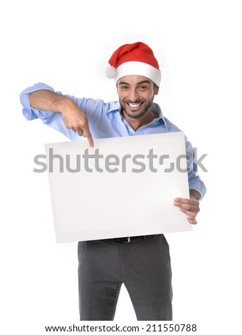 attractive business man wearing santa christmas hat holding and pointing blank billboard or placard sign copy space for adding text advertising corporate or xmas whishes isolated on white background - stock photo