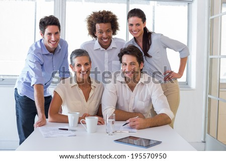 Attractive business people smiling and working together