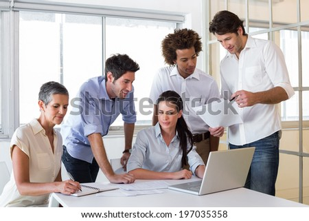 Attractive business people working hard together in the workplace
