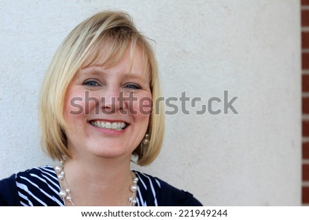Attractive Business Professional Business Woman Happy and Smiling - stock photo