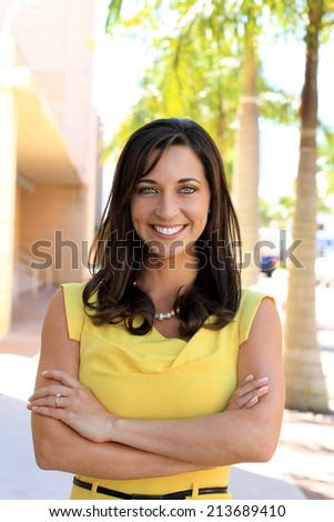 Attractive Business Professional Woman Happy Brunette Smiling Arms Crossed - stock photo