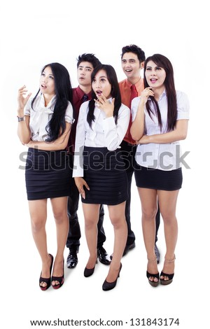 Attractive business team are looking at copy space on white background - stock photo