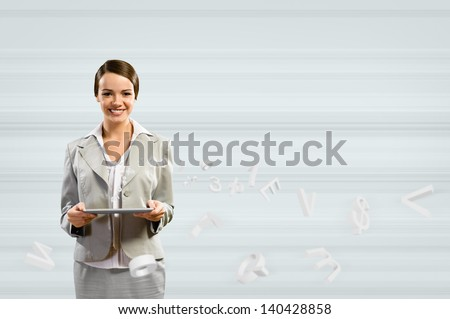 attractive business woman holding a tablet, Concept of digital technology - stock photo