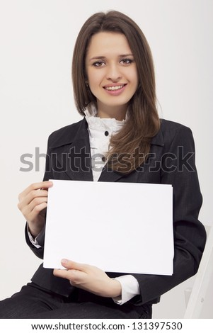 Attractive business woman holding blank paper isolated - stock photo
