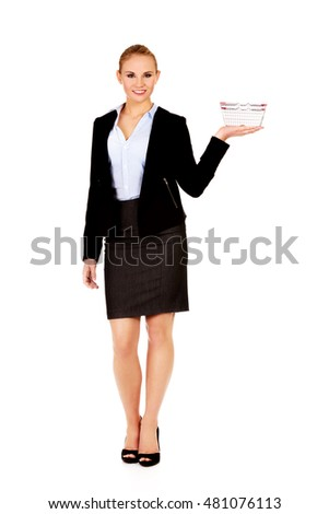 Attractive business woman holding small shopping basket