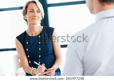 Attractive business woman in office - stock photo