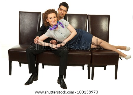 Attractive business woman lying on chairs supported by business man