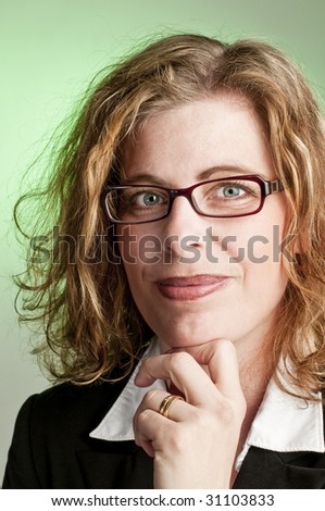 Attractive business woman on green background - stock photo
