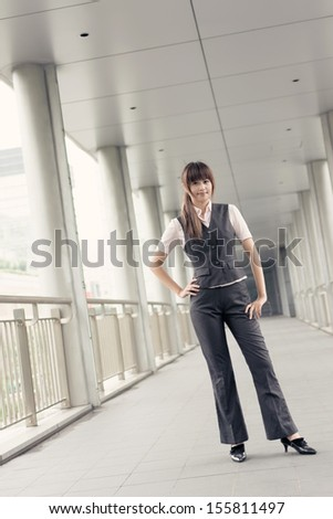 Attractive business woman, portrait in outside, Taipei, Taiwan, Asia.