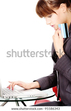 Attractive business woman shopping on line with credit card, isolated on white