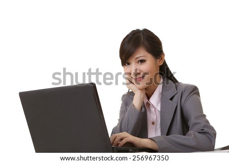 Attractive business woman sitting and smiling at you, closeup portrait. - stock photo
