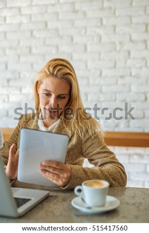 Attractive business woman working on a tablet in the office.