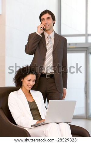 Attractive business woman working on laptop - stock photo