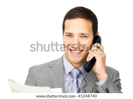 Attractive businessman on phone holding a newspaper against a white background