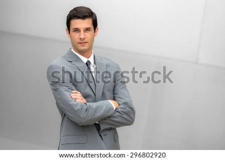 Attractive businessman portrait posing with successful expression CEO or head of company - stock photo