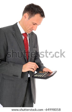 Attractive businessman using calculator. All on white background. - stock photo