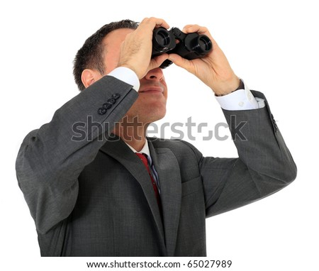Attractive businessman using spyglass. All on white background - stock photo