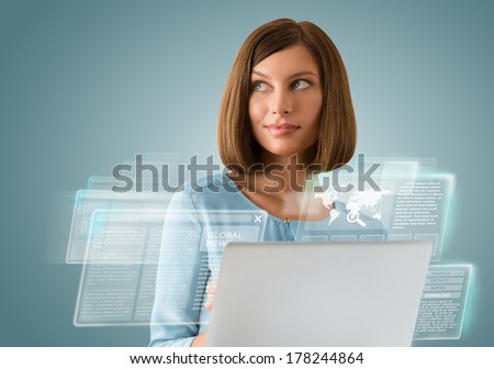 Attractive businesswoman against hightech background - stock photo